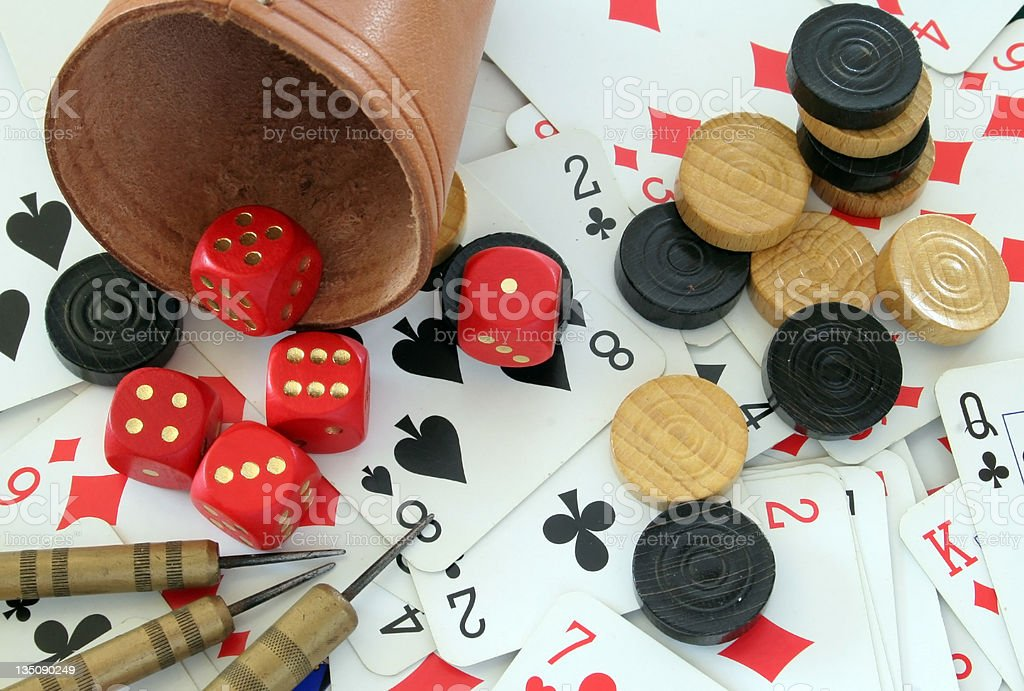 Checkers Pieces, Cards, Dice Cup and Darts royalty-free stock photo