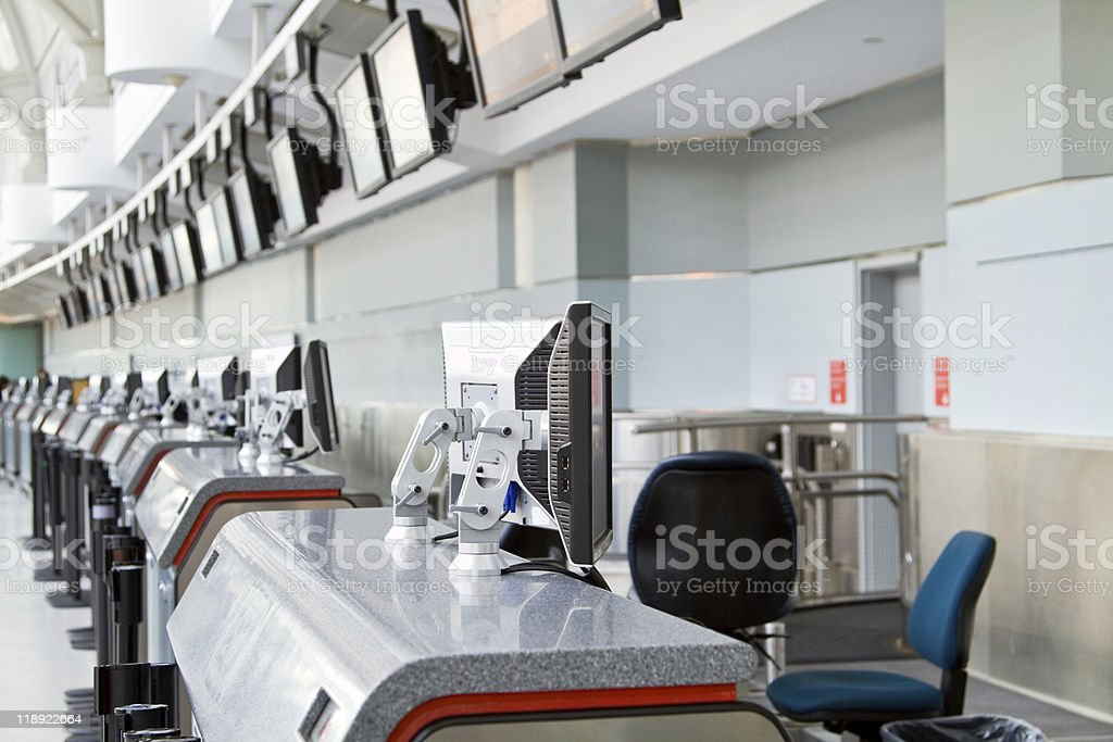 Check-in counter at airport stock photo
