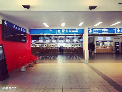 Helsinki, Finland - July 16, 2017: Check-in counters inside Silja Line Ferry Terminal building with few people at counter. From this terminal cruise ships and ferries are traveling to Estonia, Latvia, Sweden
