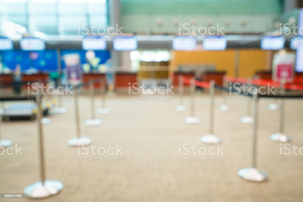 Check-in desk in airport blurred background defocused stock photo