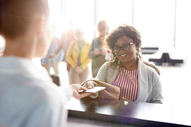 check-in of documents - identity card stock photos and pictures