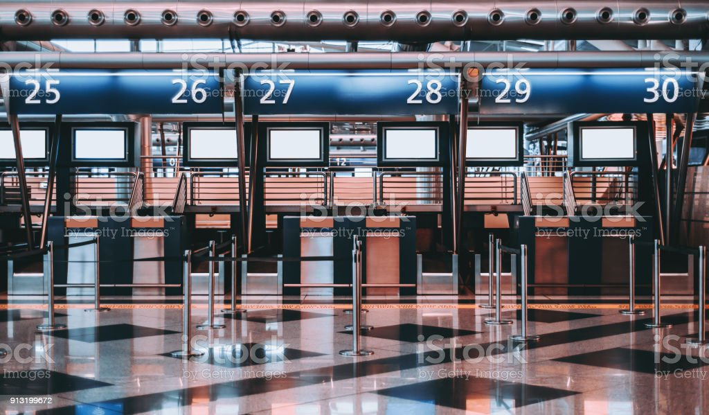 Check-in zone in modern airport terminal stock photo