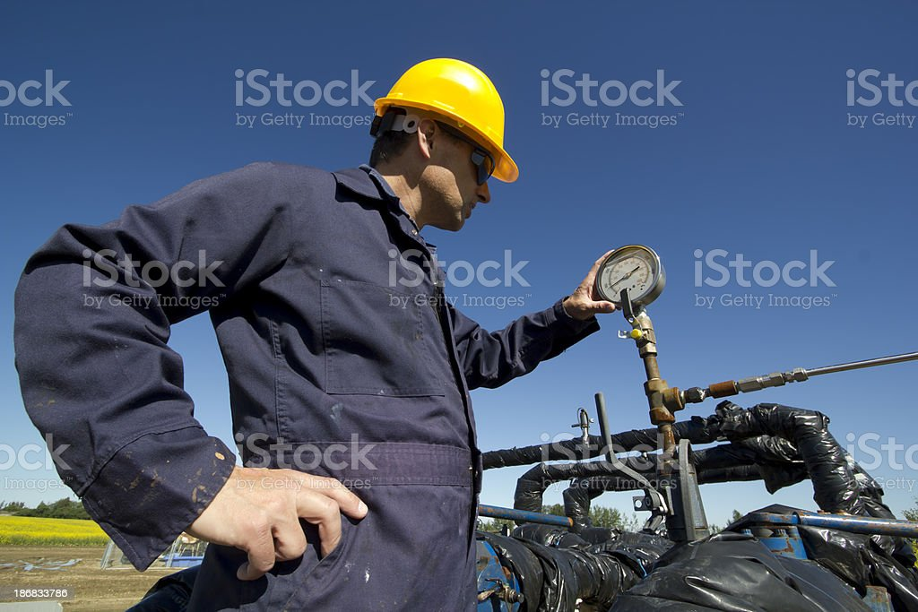 Checking a Gauge royalty-free stock photo