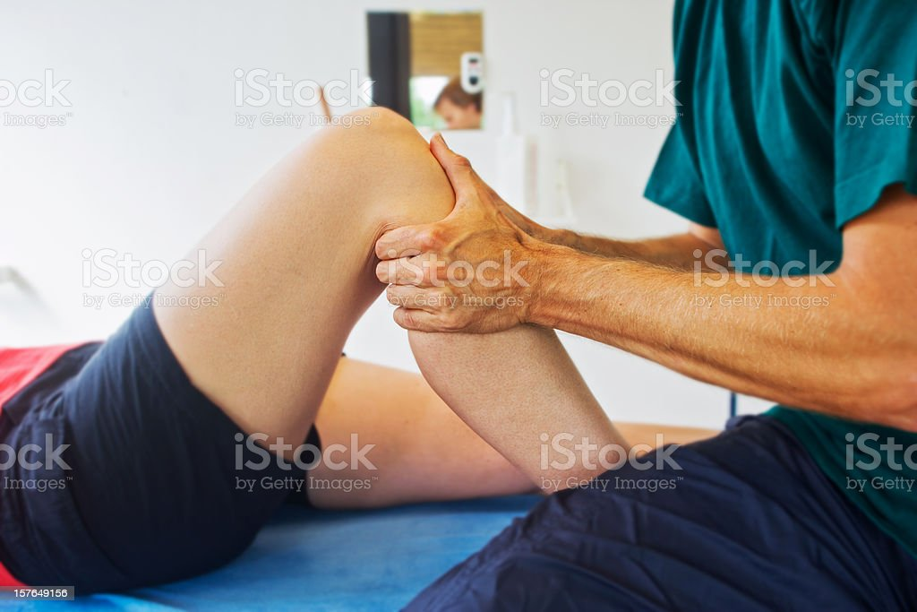 Checking a knee stock photo