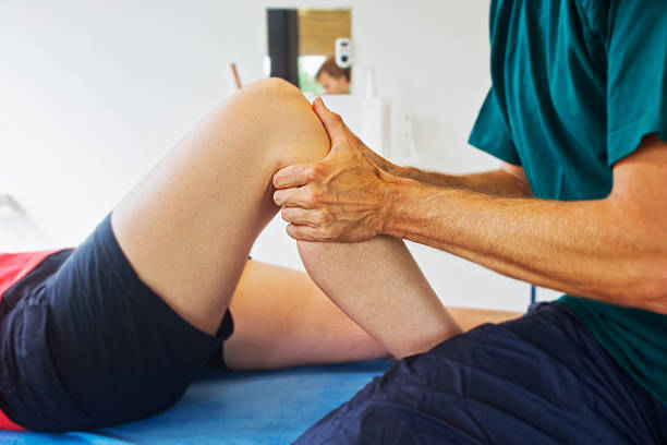 checking a knee - human knee stock photos and pictures