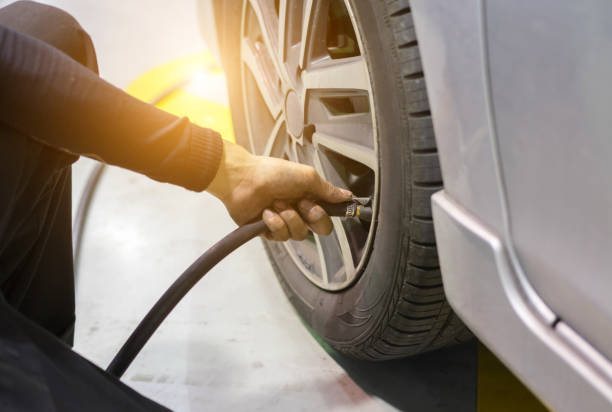 Checking /add air pressure . pumping air into auto wheel. vehicle safe concept. Checking /add air pressure . pumping air into auto wheel. vehicle safe concept. nitrogen stock pictures, royalty-free photos & images