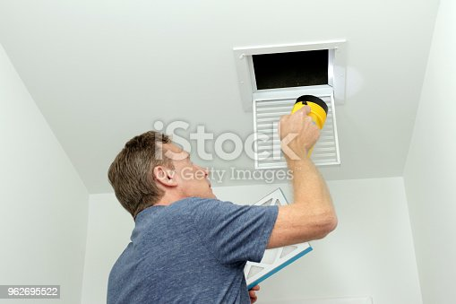895571294 istock photo Checking Air Ducts in Home HVAC System 962695522