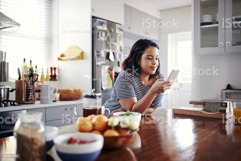 Checking all her texts stock photo