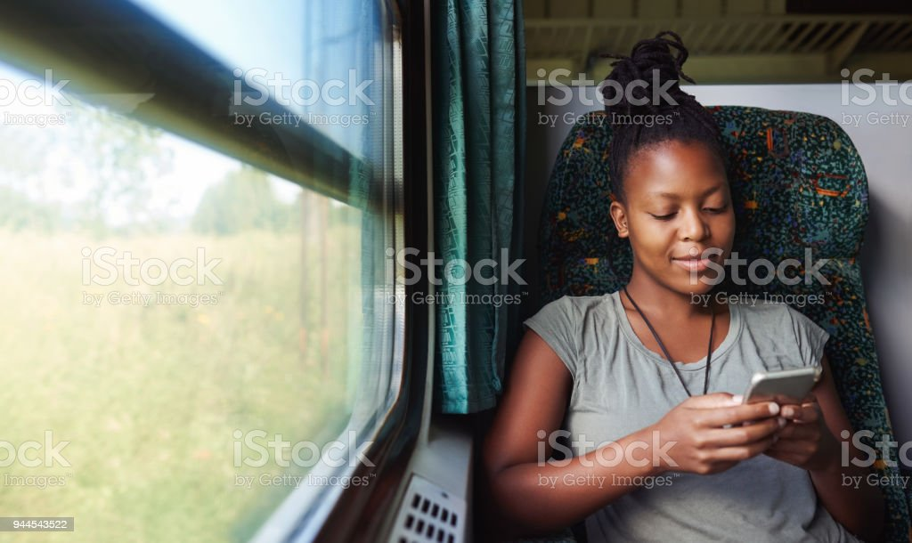 Checking apps for travelling updates stock photo