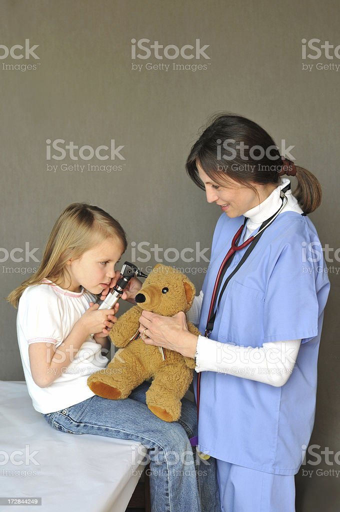 Checking bear's ear stock photo