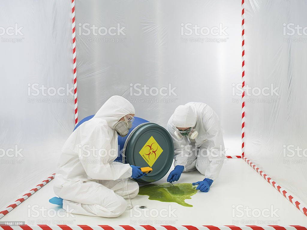 Checking  biohazard in a containment tent royalty-free stock photo
