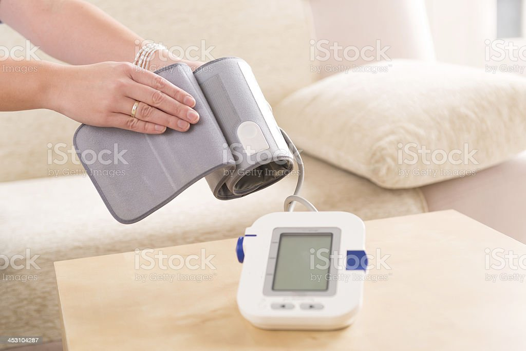 checking blood pressure at home royalty-free stock photo