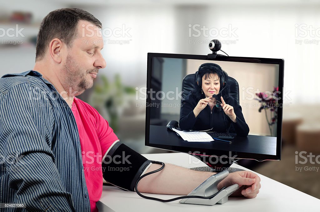 Checking blood pressure numbers online stock photo