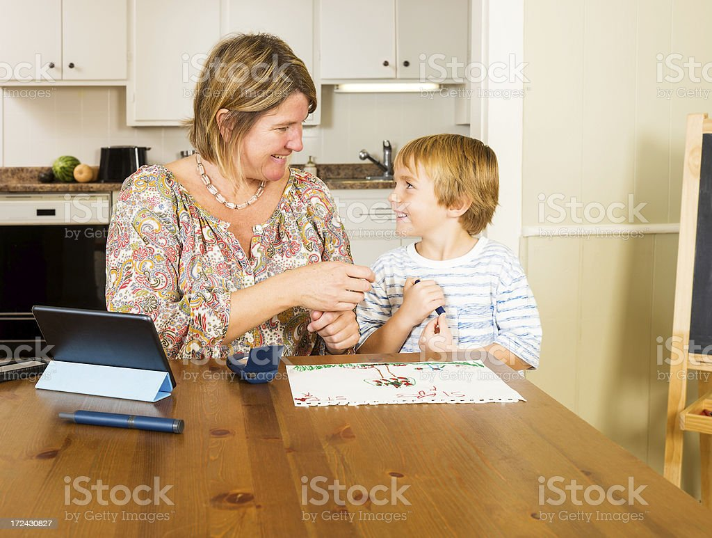 Checking blood sugar, glucose levels with mother royalty-free stock photo