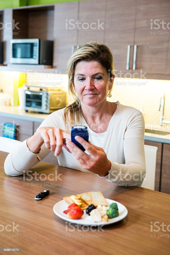 Checking blood sugar levels to monitor diabetes stock photo