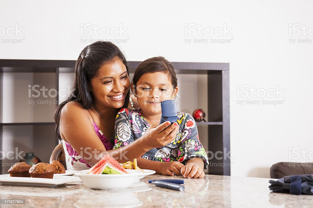 Checking blood sugar on a glaucometer stock photo