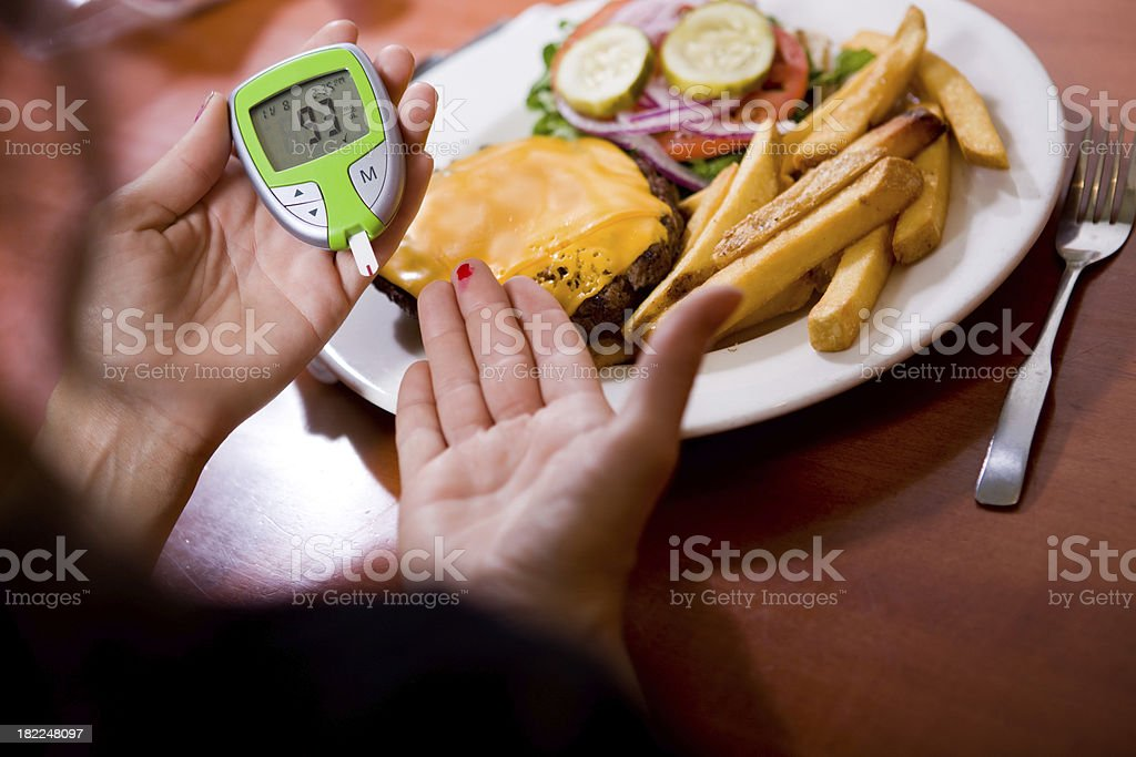 Checking Blood Sugar Reading royalty-free stock photo