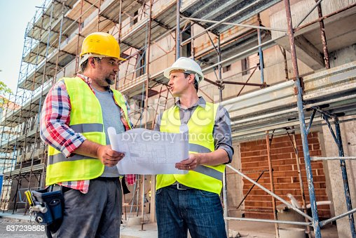 istock Checking blueprints on a construction site 637239868