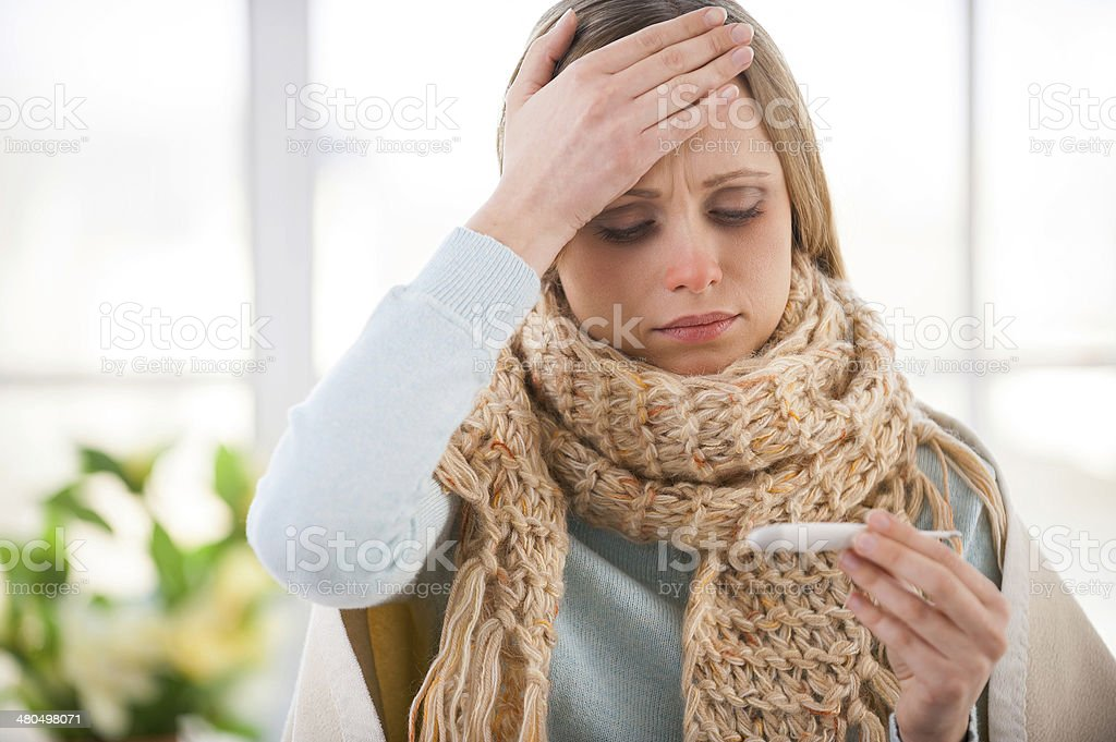 Checking body temperature. stock photo