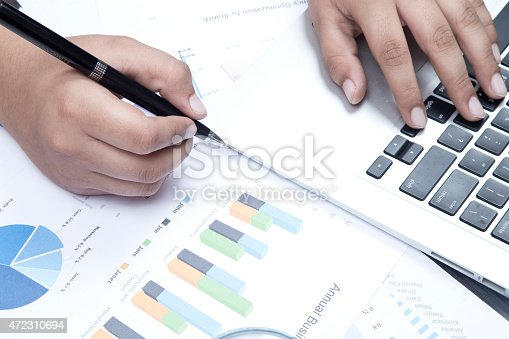 905049450 istock photo Checking Business Reports 472310694