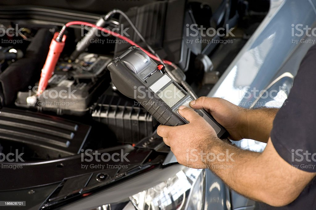 Checking Car Battery stock photo