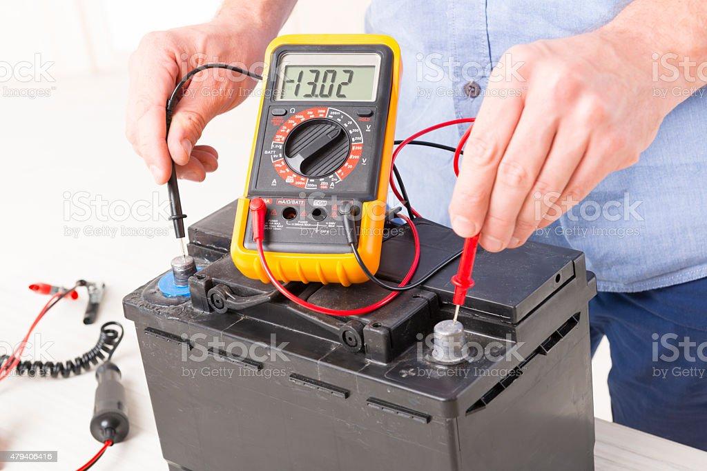 Checking car battery stock photo