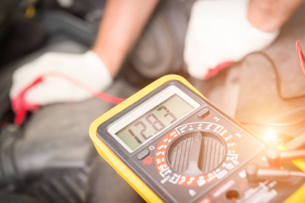 Checking car battery voltage stock photo