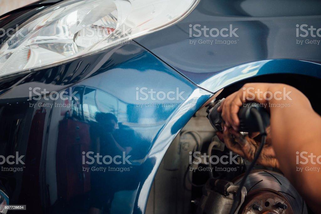 Checking car fiber bumper body part at car garage stock photo