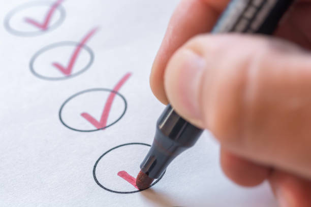 Checking completed tasks on a list controling chores stock pictures, royalty-free photos & images