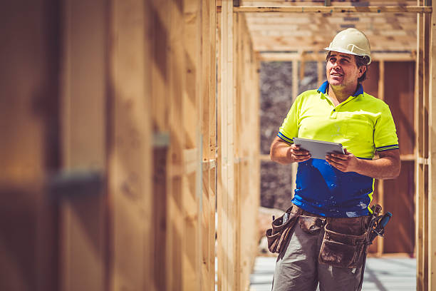 checking construction site - builders stock photos and pictures