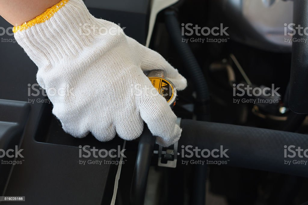 checking coolant system in the car stock photo
