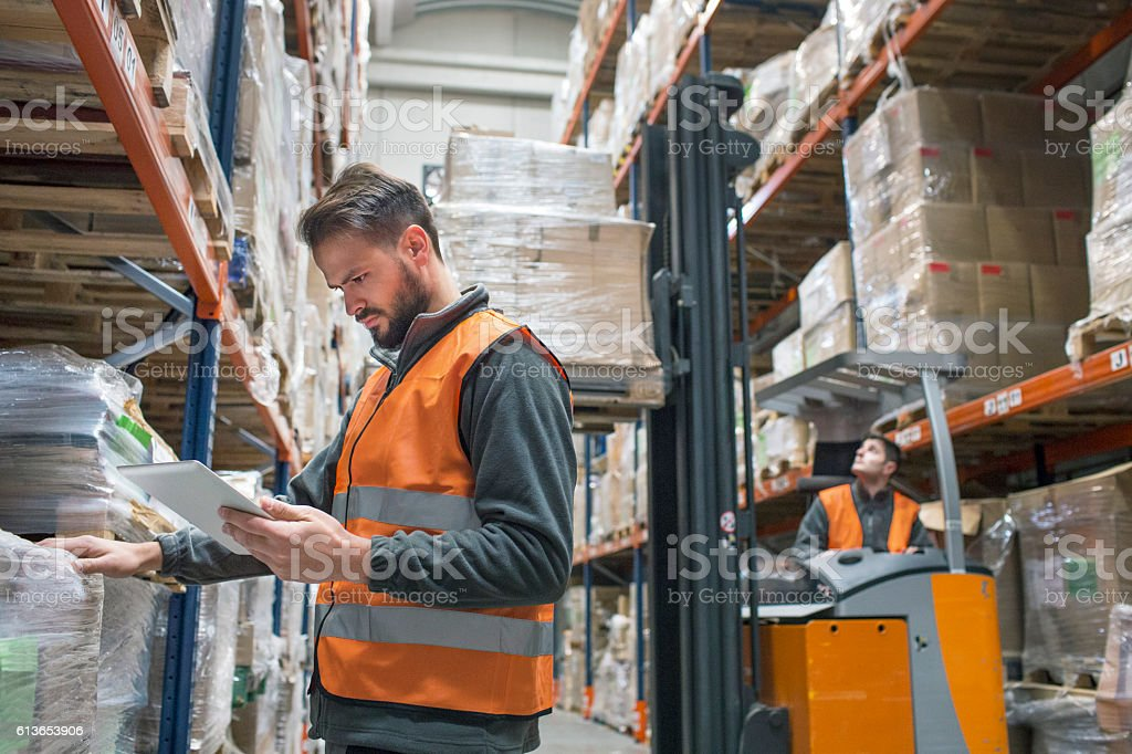 Checking delivery palet in warehouse stock photo