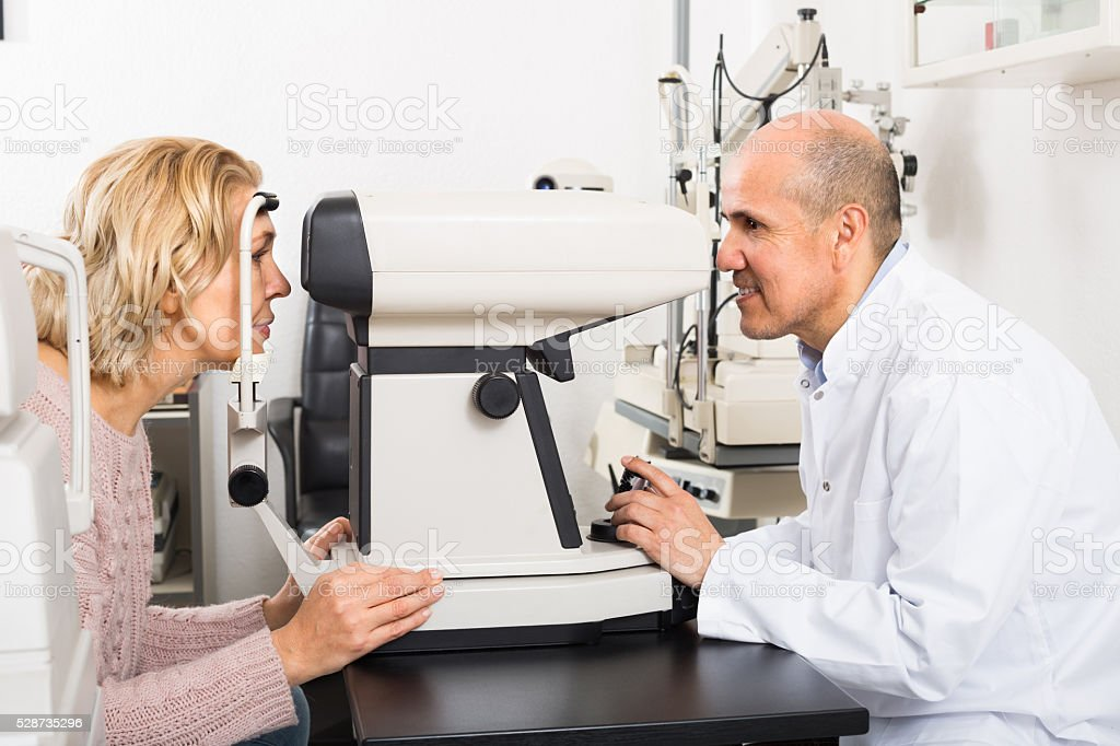 Checking eyesight in clinic stock photo