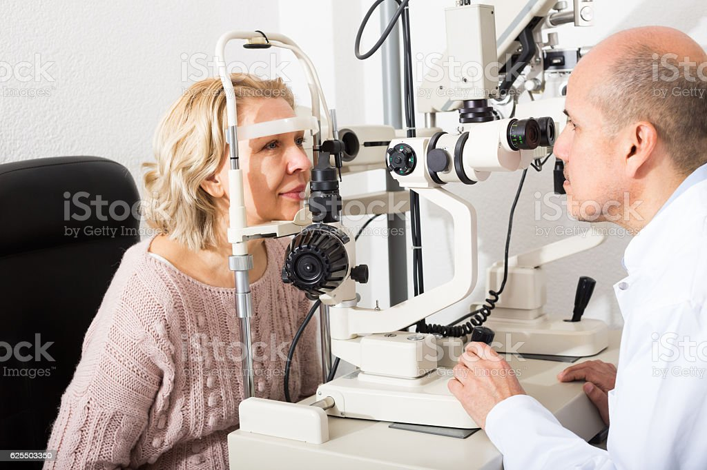 Checking eyesight in clinic stock photo
