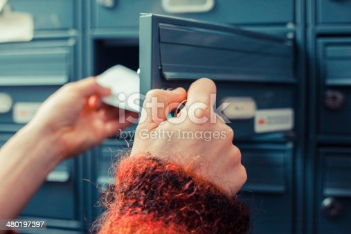 480197395istockphoto Checking for mail 480197397