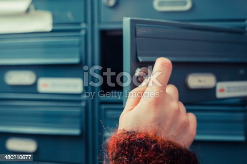 480197395istockphoto Checking for mail 480210677