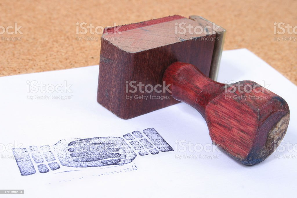 Checking hand stamper royalty-free stock photo