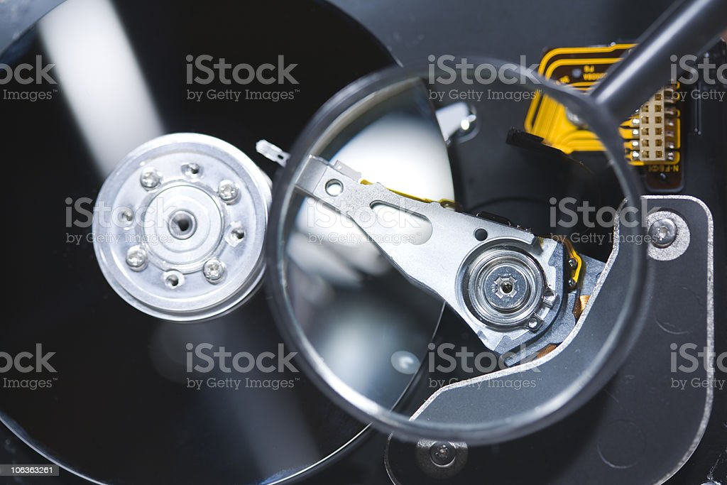 Checking Hard Drive with loupe royalty-free stock photo