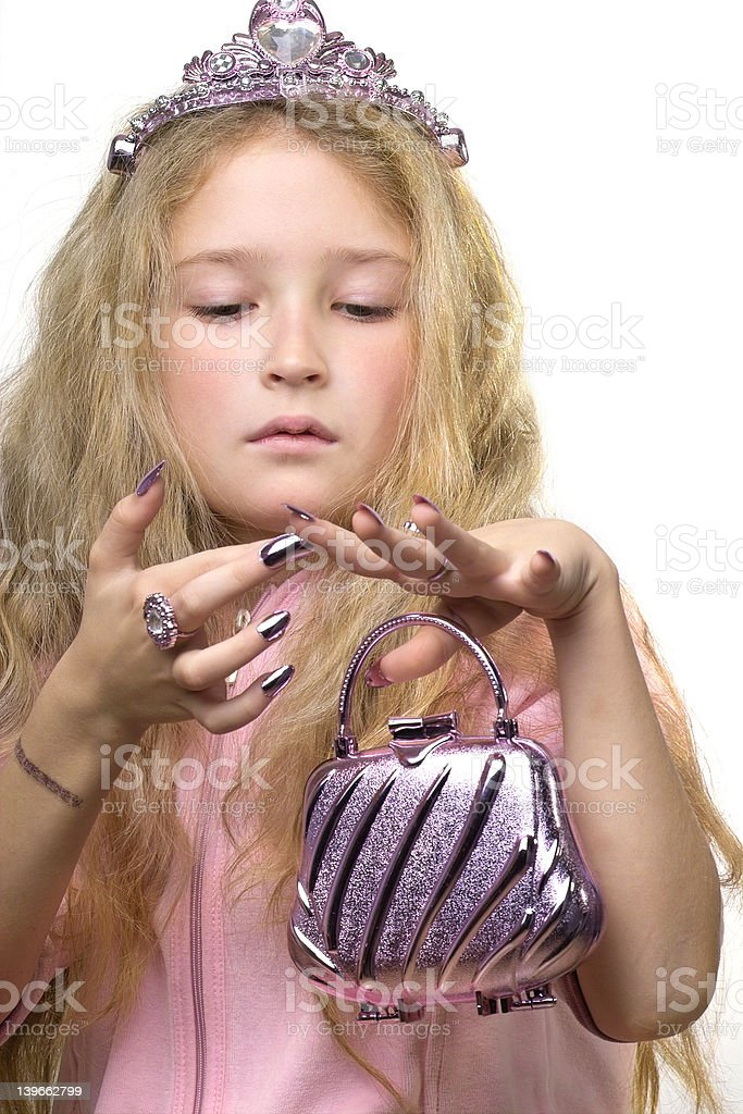 Checking her manicure royalty-free stock photo