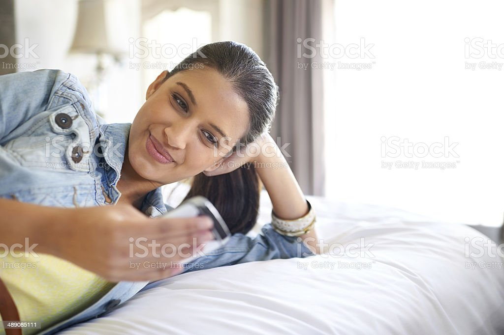 Checking her messages stock photo