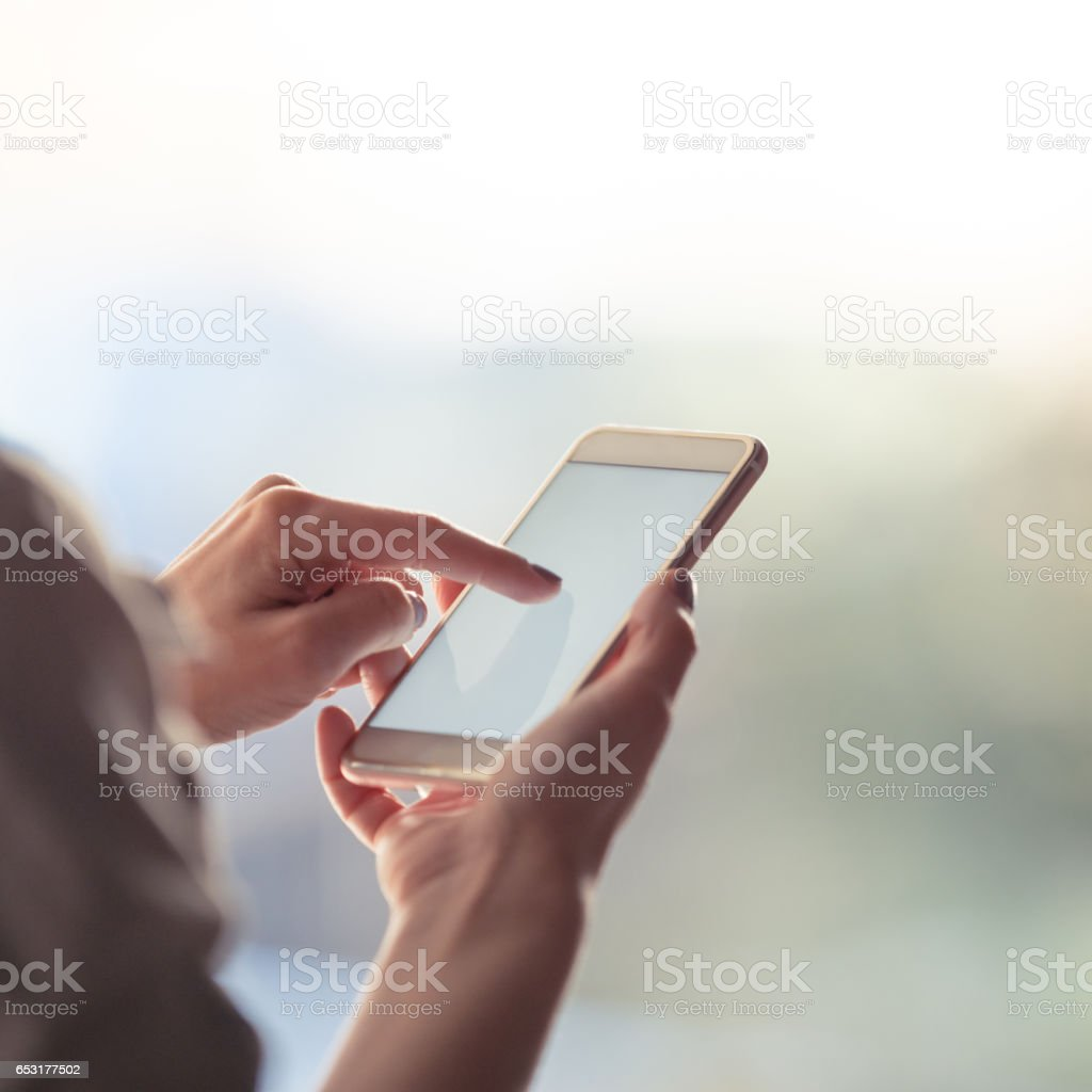 Checking her notifications stock photo