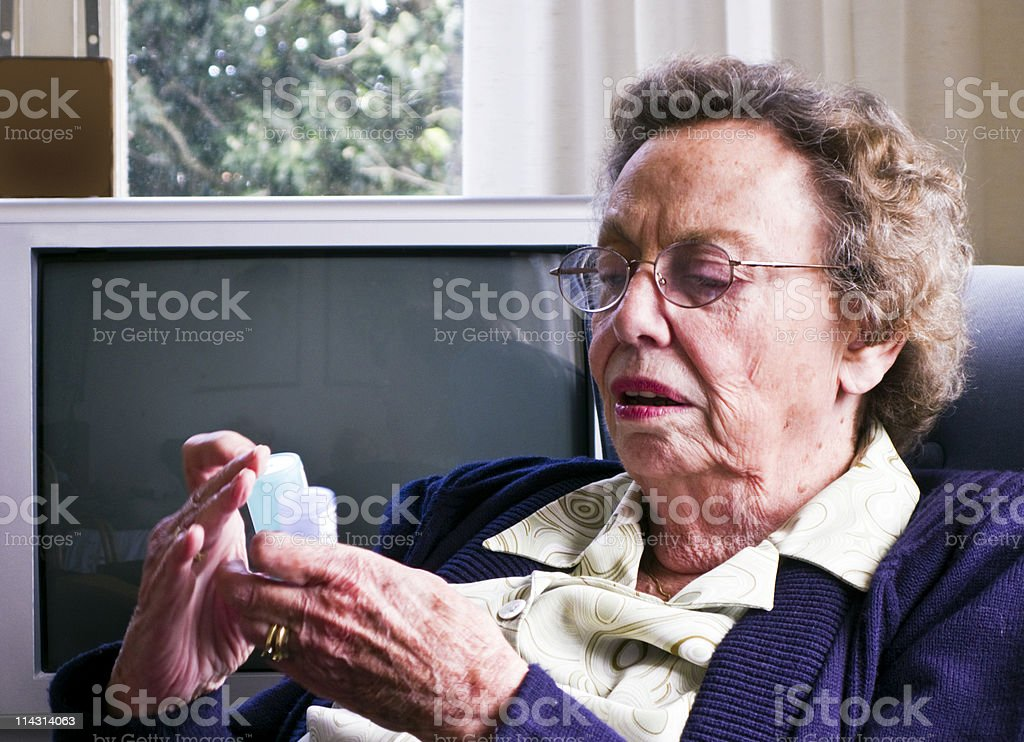 Checking her pills royalty-free stock photo