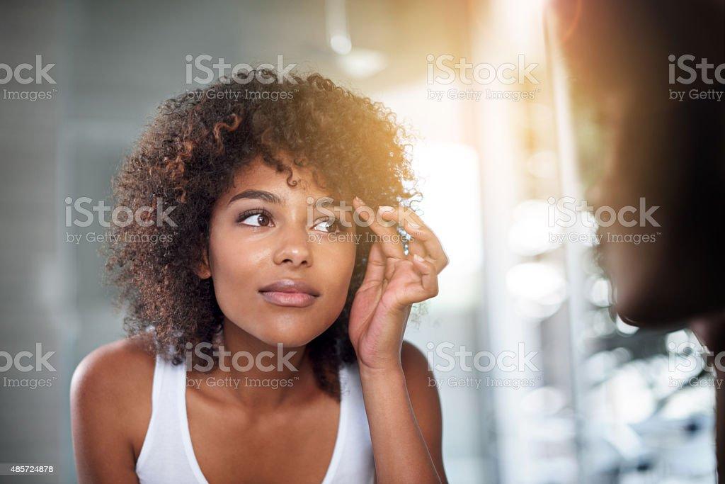 Checking her skin stock photo