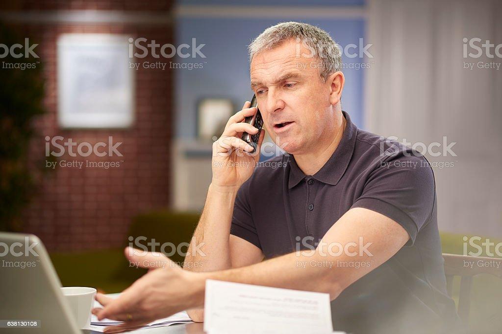 checking his accounts stock photo
