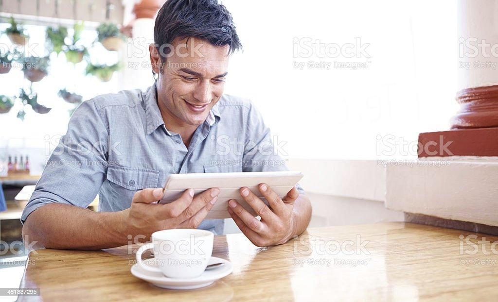 Checking his latest social media sites stock photo