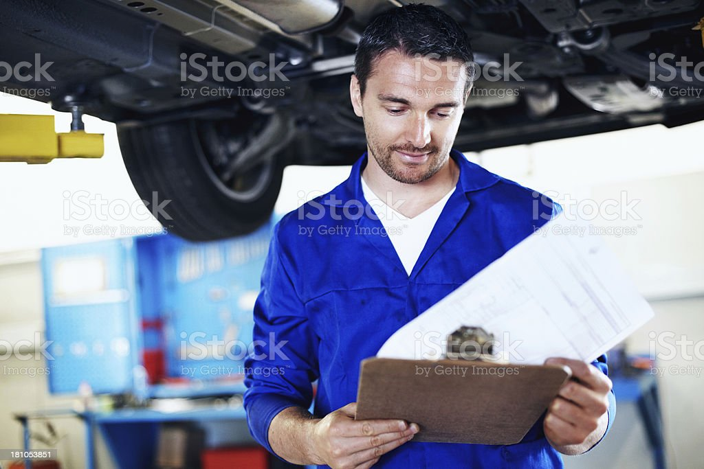 Checking his review list thoroughly stock photo
