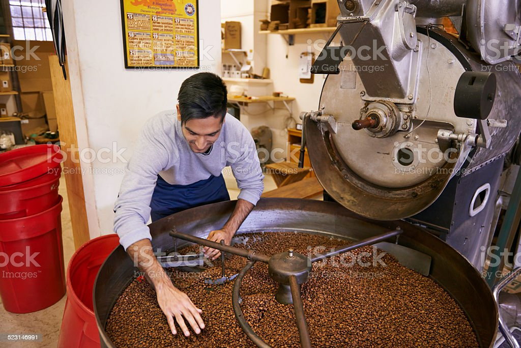 Checking his roast stock photo
