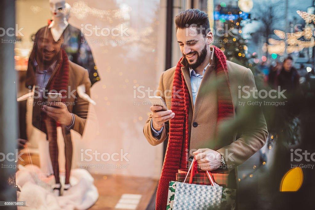 Checking his shopping list