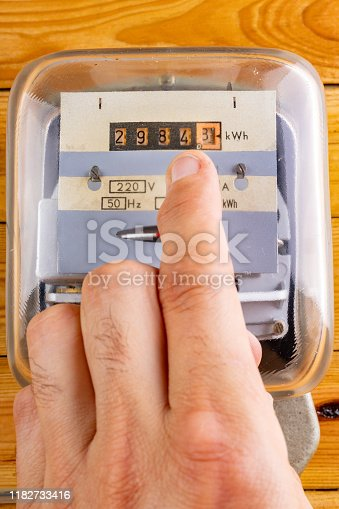 istock Checking household electricity consumption. A device for measuring the consumption of electricity. Clear background. 1182733416