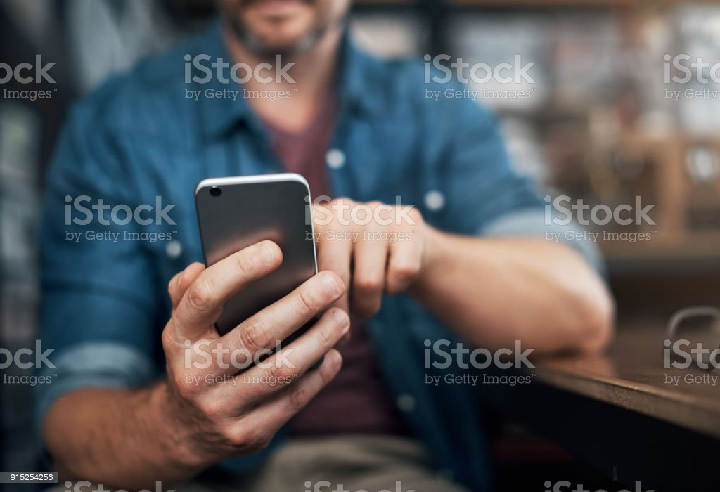 Checking in on texts from clients stock photo